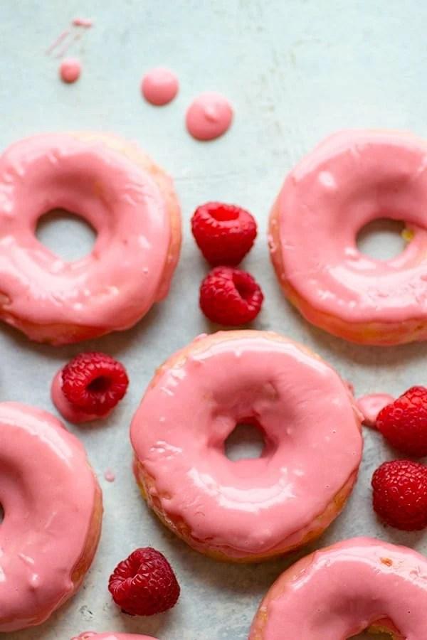Raspberry-Glazed Lemon Sour Cream Donuts - Soft, tangy lemon sour cream donuts are glazed in a sweet raspberry glaze and a much healthier way to get your donut fix!