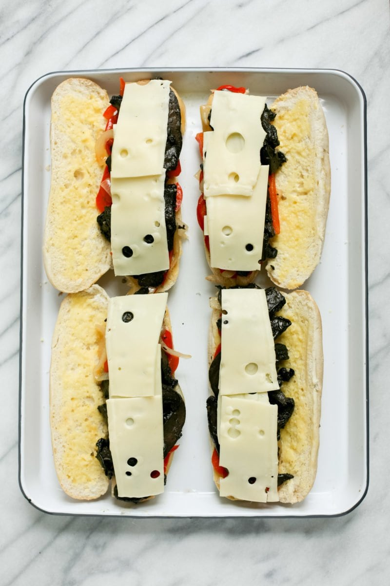 Overhead shot of portabella cheesesteaks, open-faced and uncooked