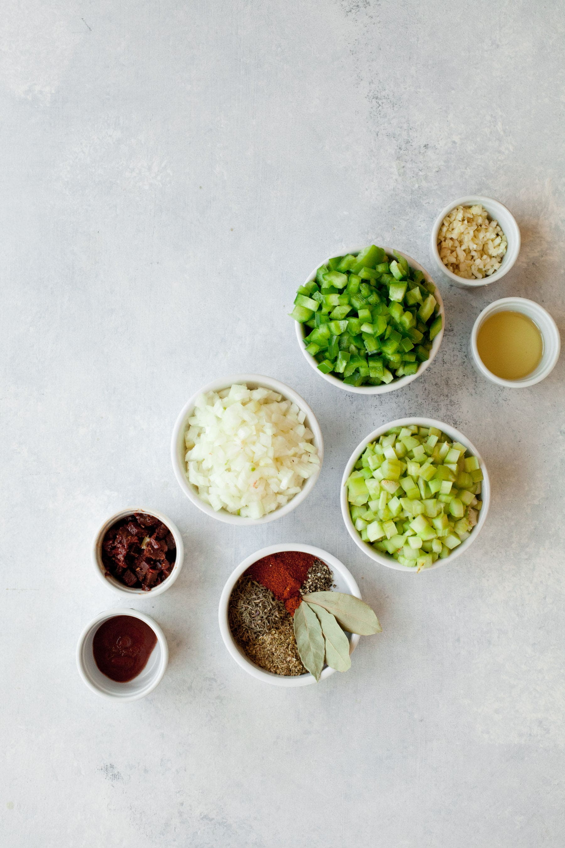 Ingredients for a Vegan Red Beans and Rice recipe in individual bowls
