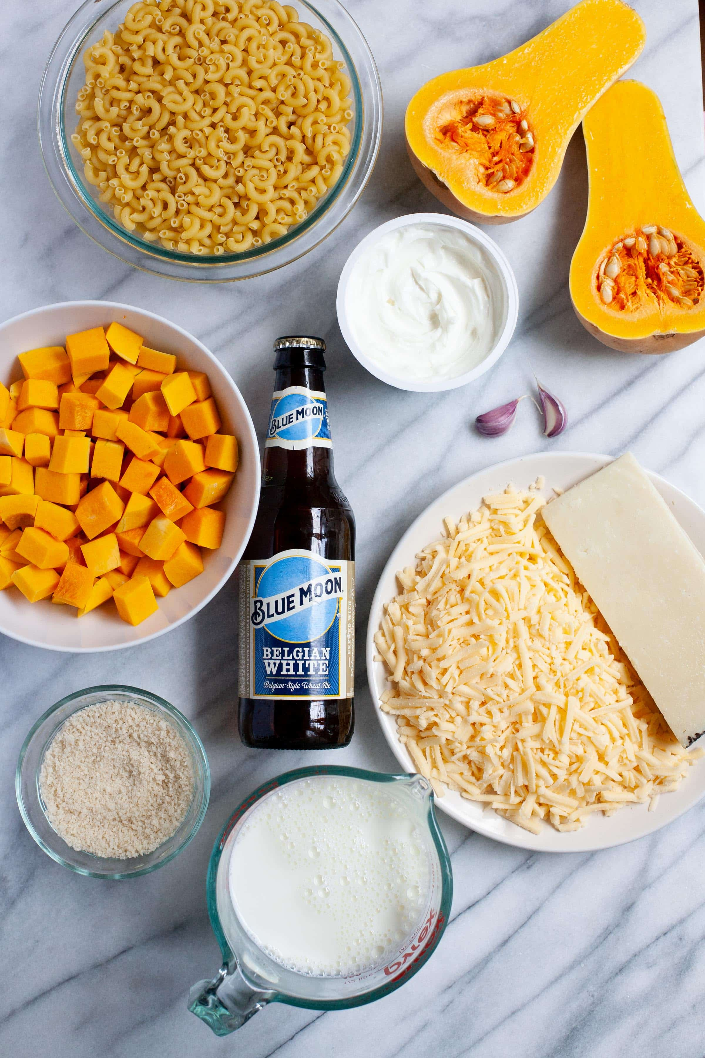 Ingredients for Beer and Butternut Squash Macaroni and Cheese in individual bowls