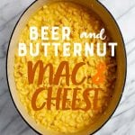 """Beer and Butternut Squash Macaroni and Cheese in a Dutch oven. A text overlay reads """"Beer and Butternut Mac & Cheese."""""""