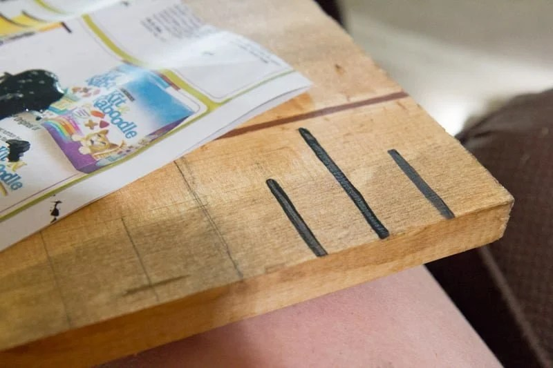 Giant Wooden Growth Chart Ruler with some of the height marks painted in, and some still only in pencil.