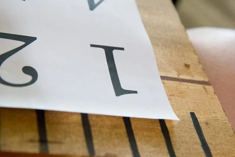 Paper with the numeral one on top of a giant wooden ruler.