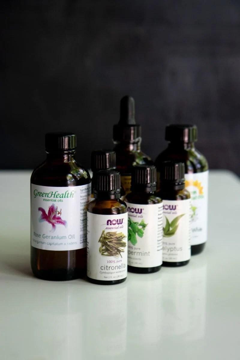 Side shot of a cluster of bottles of essential oils
