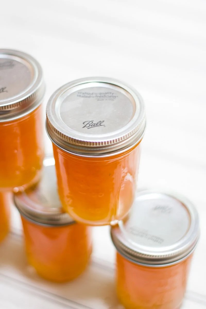 Stacked jars full of salted cantaloupe jam.