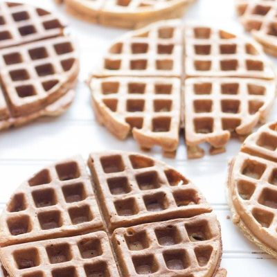 Whole Wheat Frozen Waffles sit on a white background.