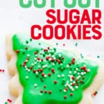 """Sugar cookies cut out and frosted to look like Christmas trees. A text overlay reads """"Perfect Cut Out Sugar Cookies."""""""