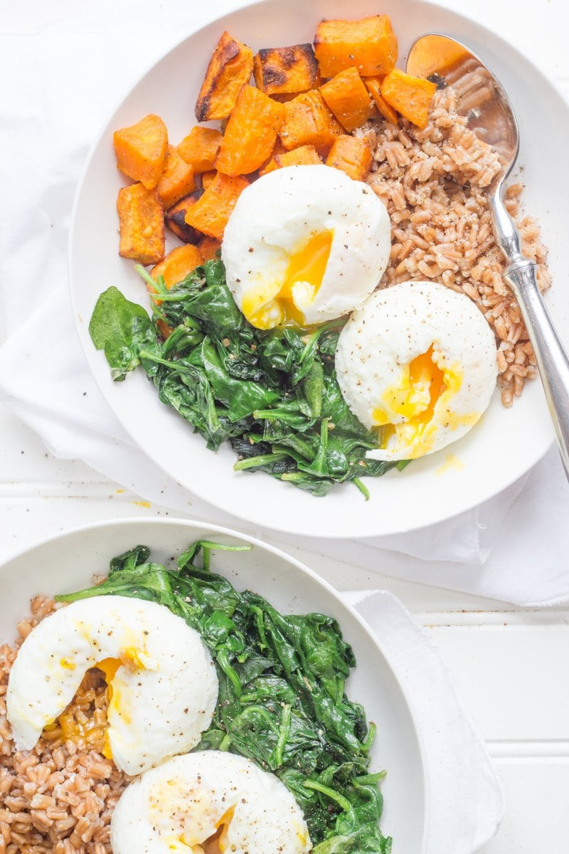 Two Curried Sweet Potato Breakfast Bowls in white bowls with spoons