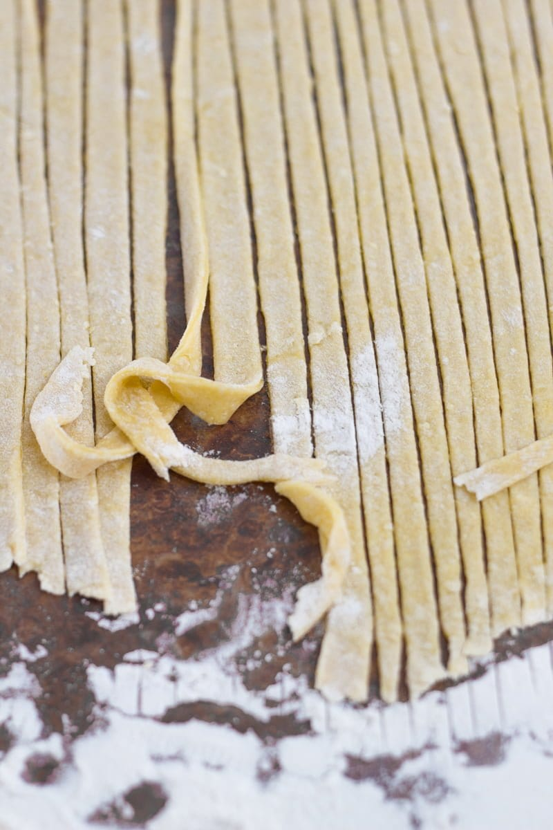 Fresh egg noodles cut into long strands.