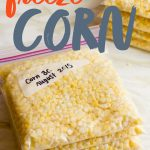 "A stack of zip-top bags filled with fresh corn kernels. A text overlay reads, ""How to Freeze Corn."""