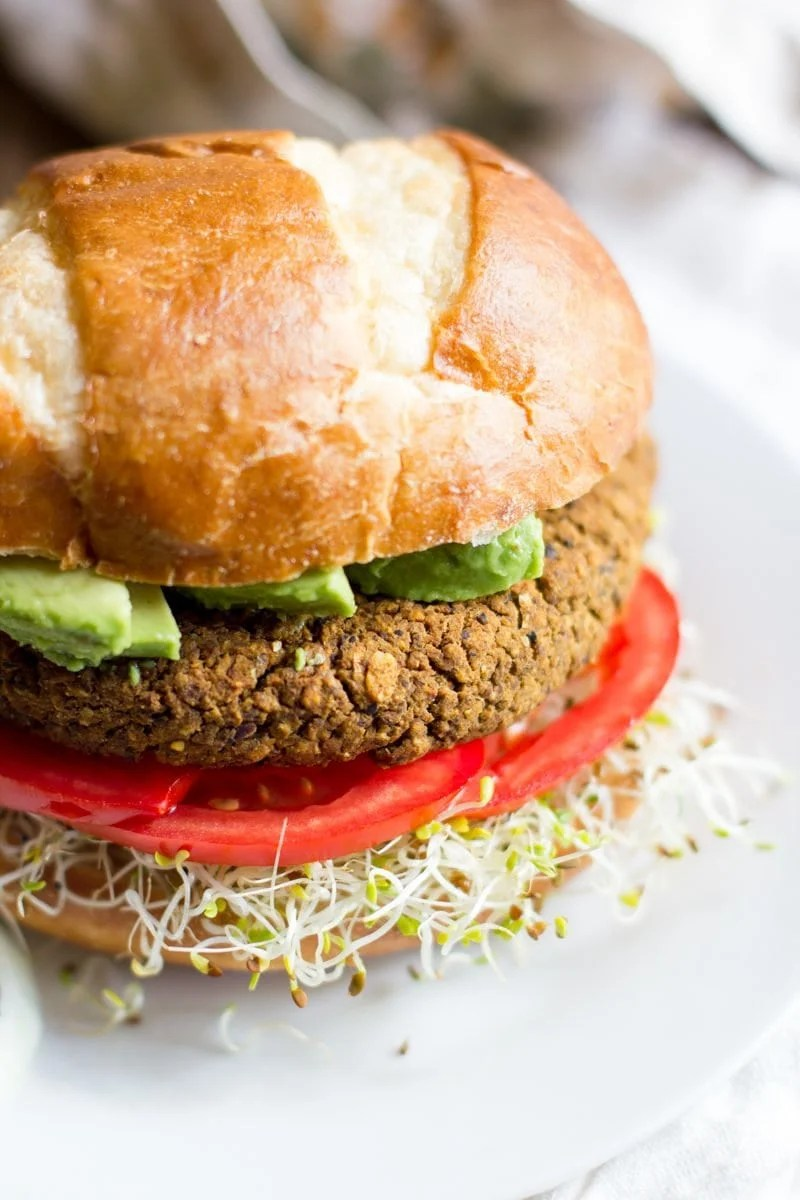 A Pumpkin Black Bean Burger sits on a white plate.