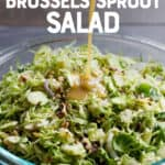"""Dressing pouring on Shaved Brussels Sprout Salad with Apples. Text overlay reads """"Shaved Brussels Sprout Salad""""."""