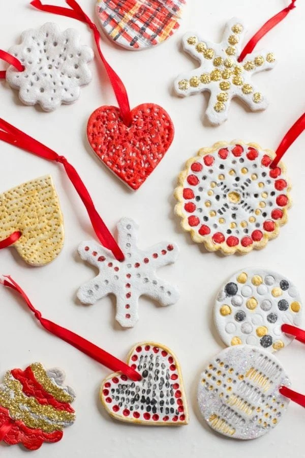 Salt Dough Ornaments painted white, red, silver, and gold lay on a white background.