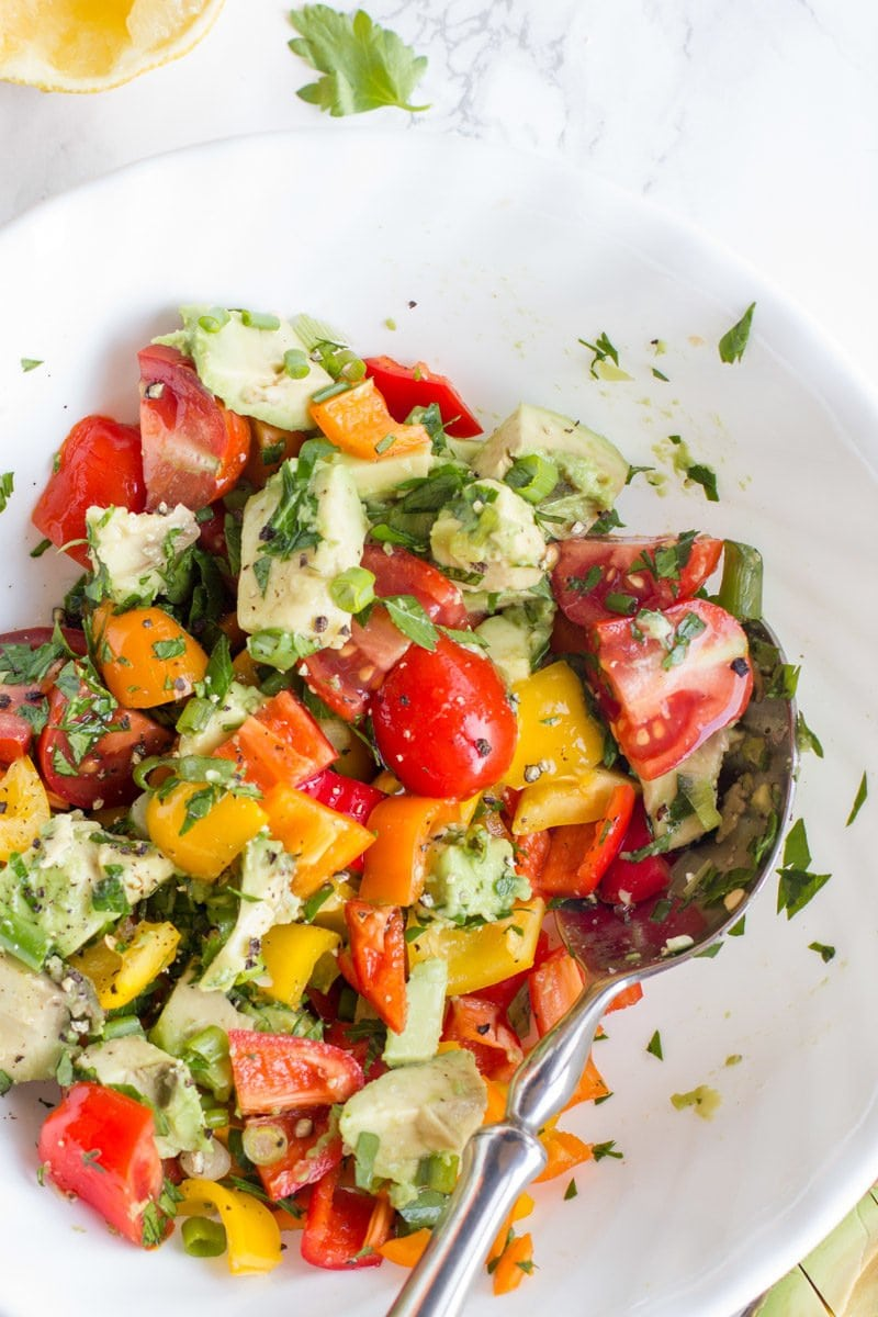 The final Avocado Bell Pepper Salad is mixed together in a white bowl