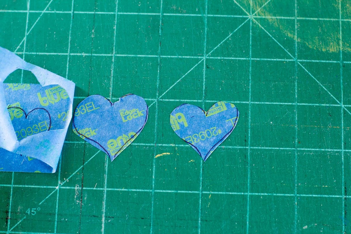 Hearts made out of painter's tape on a cutting mat