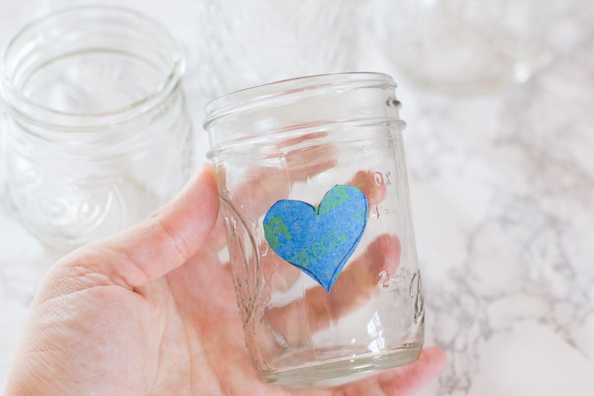 Heart made of painter's tape on an empty mason jar