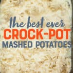 "An overhead view of mashed potatoes in the basin of a slow cooker. A text overlay reads ""The Best Ever Crock-Pot Mashed Potatoes."""