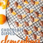 "Slices of clementine half-covered in chocolate on a wire rack. A text overlay reads ""Chocolate Dipped Clementines."""