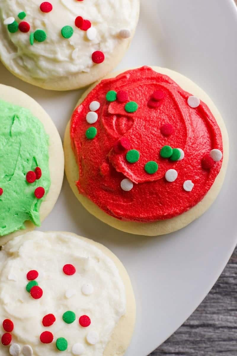 Lofthouse Sugar Cookies decorated in white, green, and red frosting, topped with sprinkles