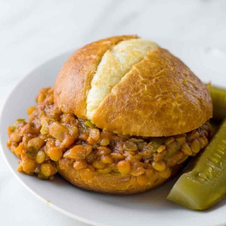 A finished sloppy joe sits on a plate.