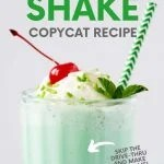 """Close up on a Shamrock Shake copycat, garnished with maraschino cherry and whipped cream, with a striped straw. A text overlay reads """"Shamrock Shake Copycat Recipe."""""""