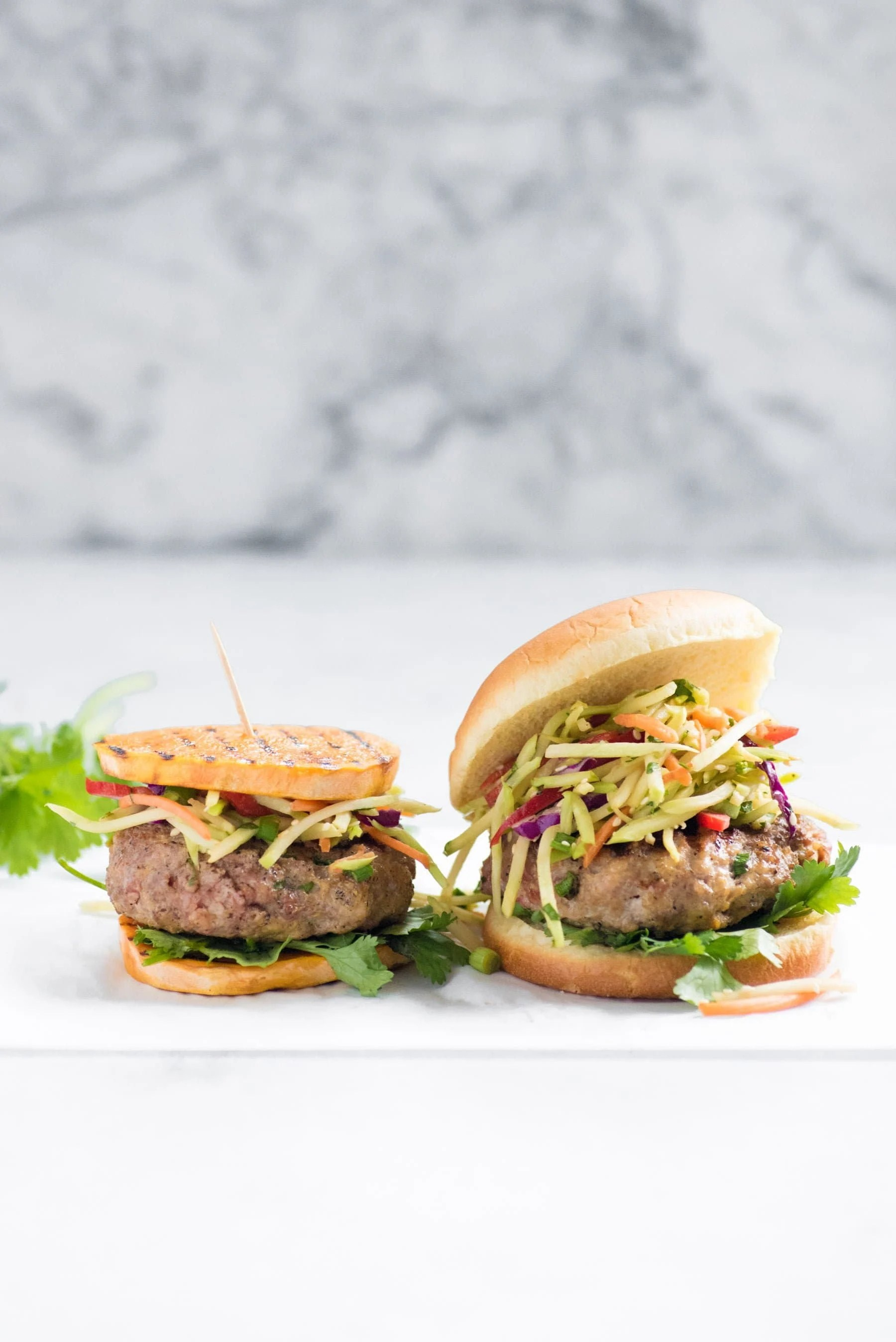 two Asian Pork Burgers with Broccoli Slaw - One on Sweet Potato Rounds, One on Bun