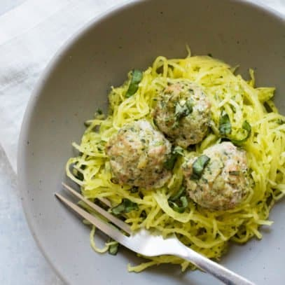 Overhead shot of Turkey Florentine Meatballs with Pesto Spaghetti Squash in a bowl