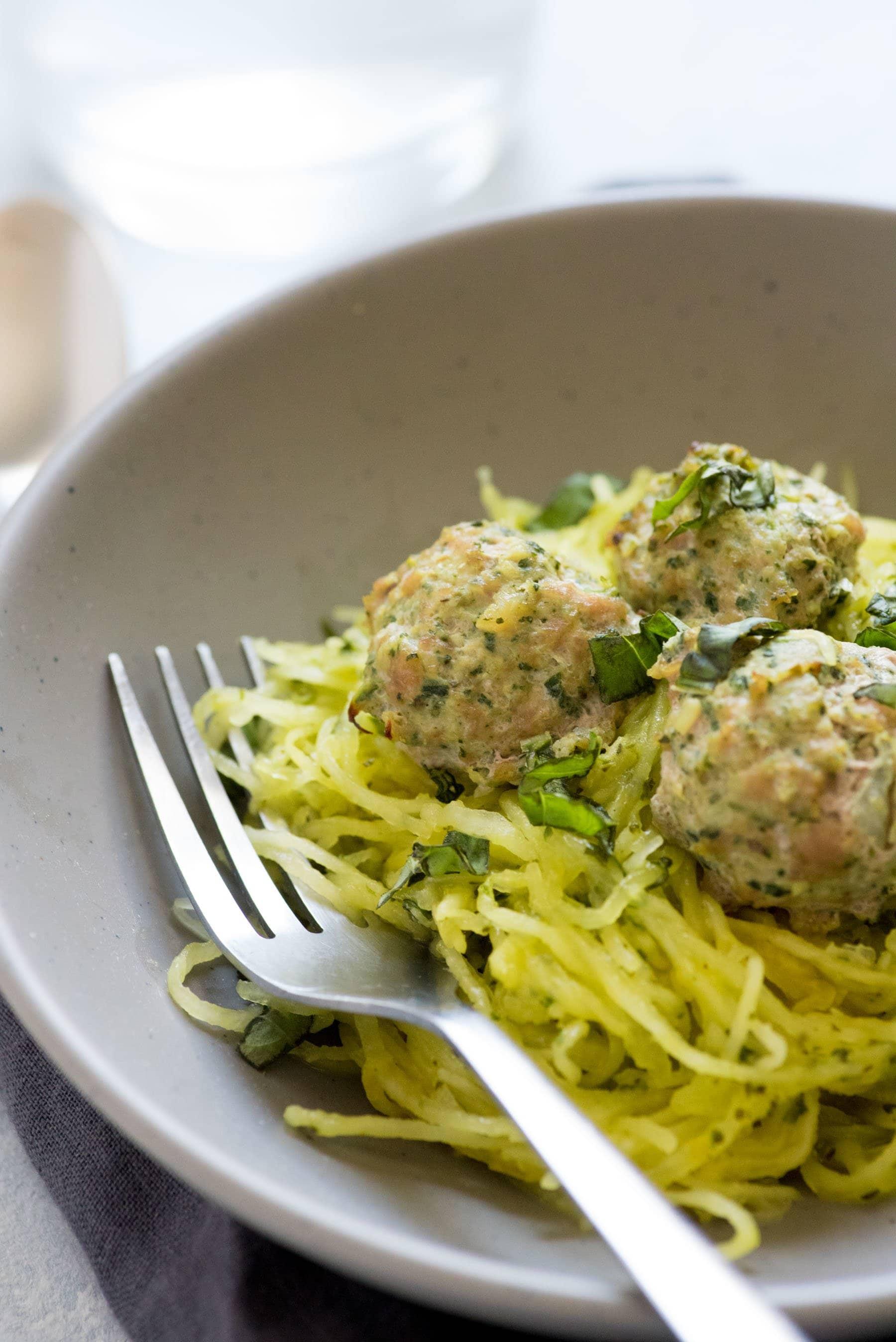 Side angle shot of Turkey Florentine Meatballs with Pesto Spaghetti Squash
