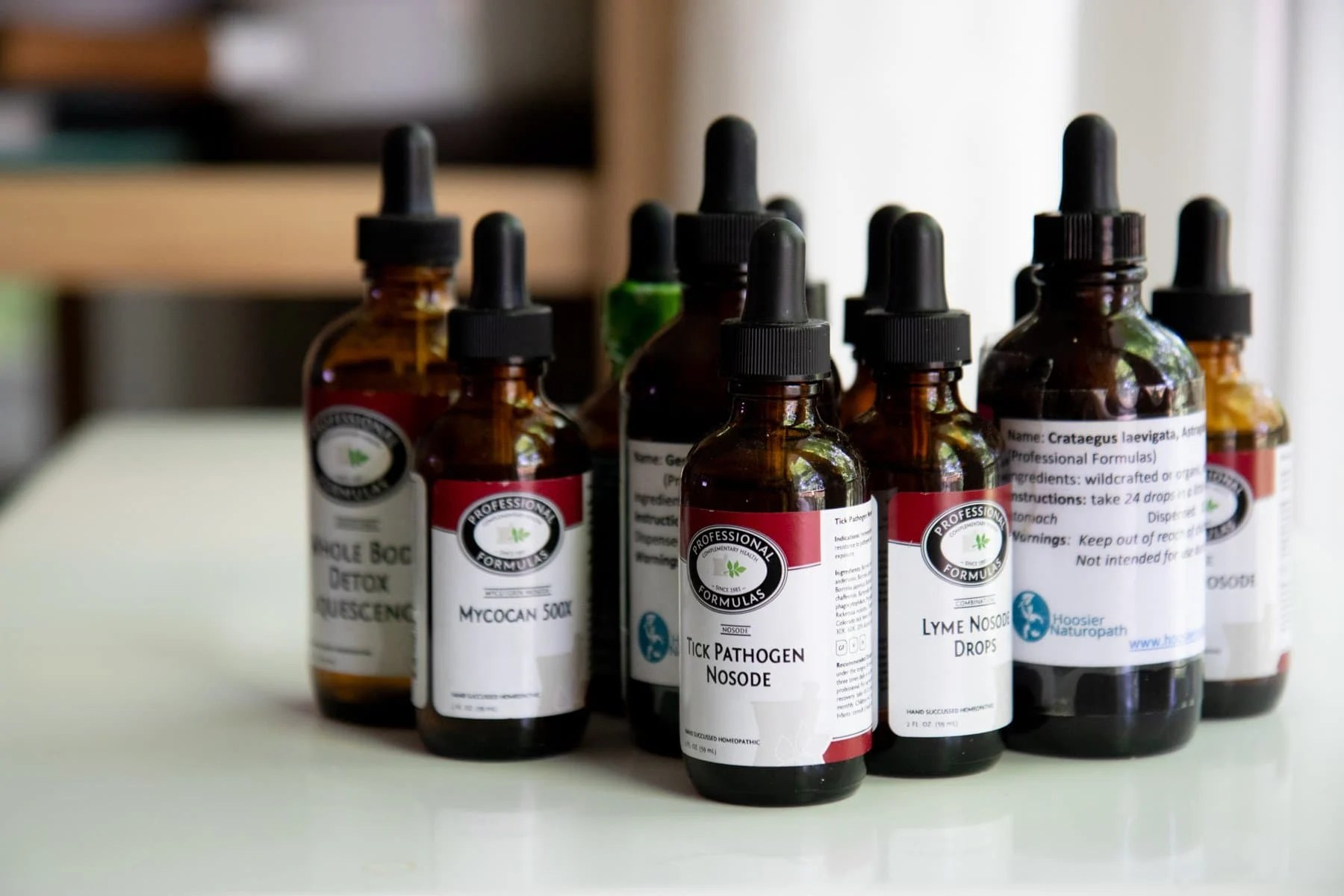Cluster of eyedropper bottles with herbal remedies for Lyme Disease