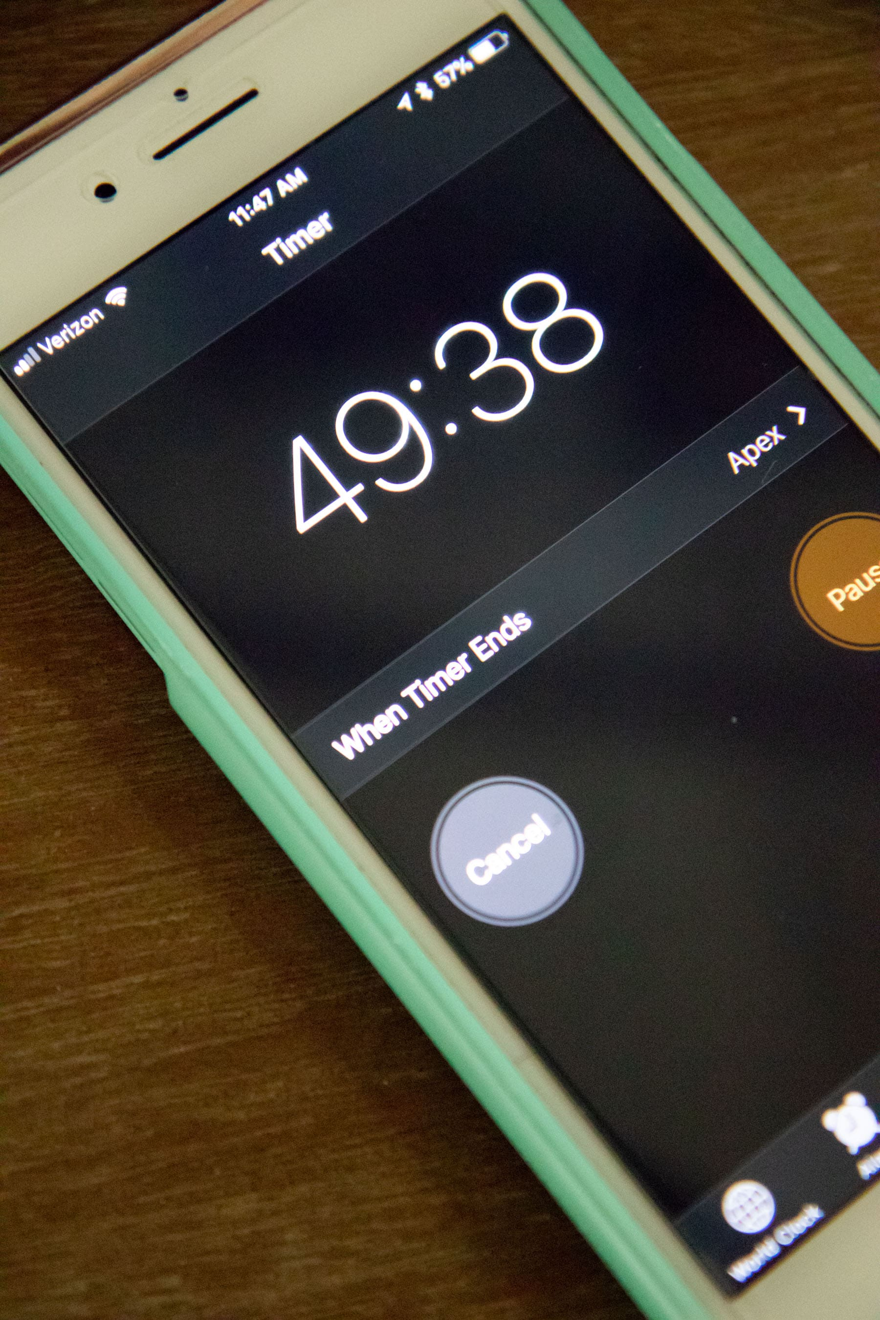 iPhone in a green case showing a timer reading 49:38