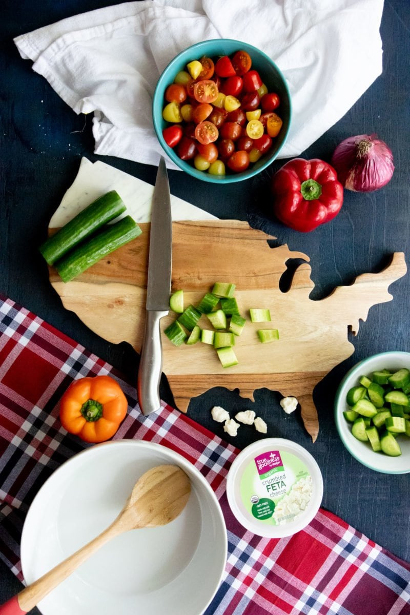 Overhead shot of chopped vegetables on a United States shaped cutting board
