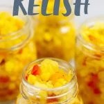 Side angle shot of Homestyle Corn Relish in glass mason jars, ready for canning, with a text overlay
