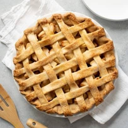 Apple pie with a lattice top, on top of a white towel