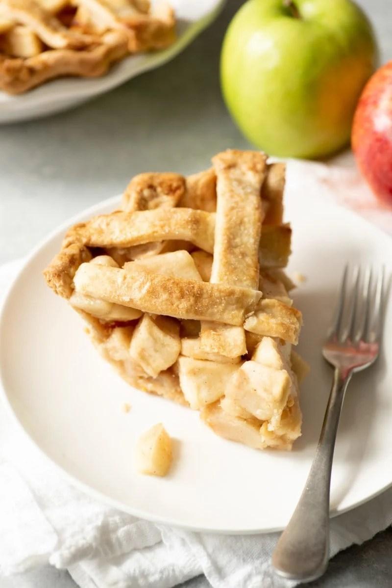 Slice of apple pie with a lattice top crust