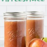"""2 tall glass jars of Instant Pot Applesauce with some apples, with the text """"Perfect Instant Pot Applesauce"""""""