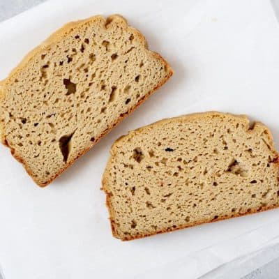 Two slices of Grain-Free Sandwich Bread on a white background