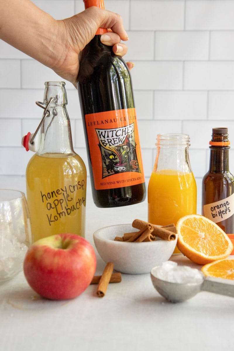 Ingredients for Mulled Wine Kombucha Spritzer on a white background