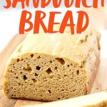 """Loaf of Grain-Free Cashew Sandwich Bread with two slices cut off. Text overlay reads """"Grain-Free Blender Sandwich Bread."""""""