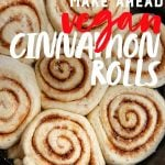 "Unbaked Make-Ahead Vegan Cinnamon Rolls nestled in a cast iron skillet, ready to be baked. A text overlay reads ""Make Ahead Vegan Cinnamon Rolls"""