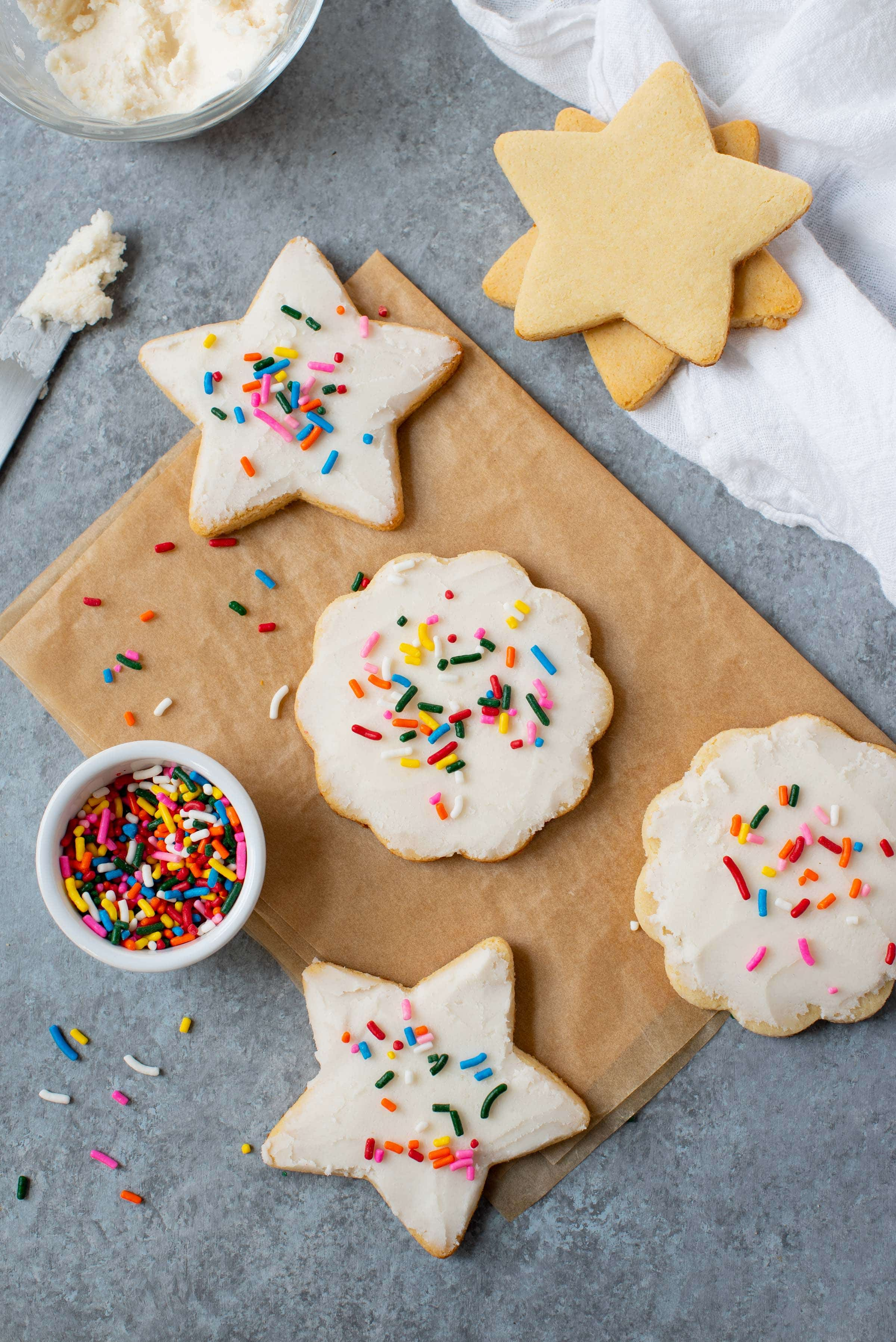 Grain-free paleo sugar cookies with coconut butter frosting and rainbow sprinkles