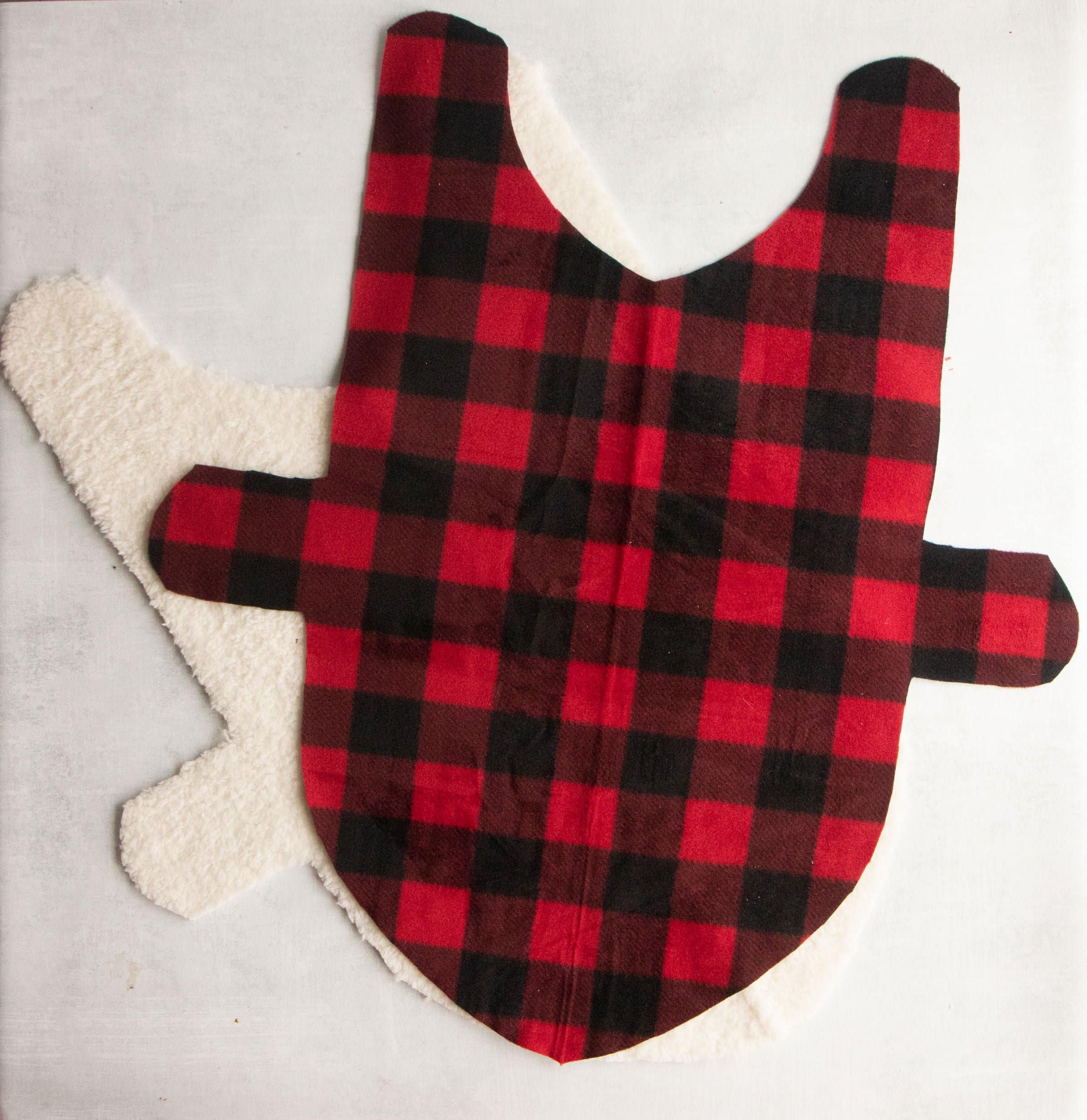 Fleece and faux fur fabric cut out for a dog coat