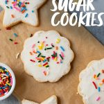 """Grain-free paleo sugar cookies with coconut butter frosting and rainbow sprinkles. A text overlay reads """"Paleo Sugar Cookies."""""""