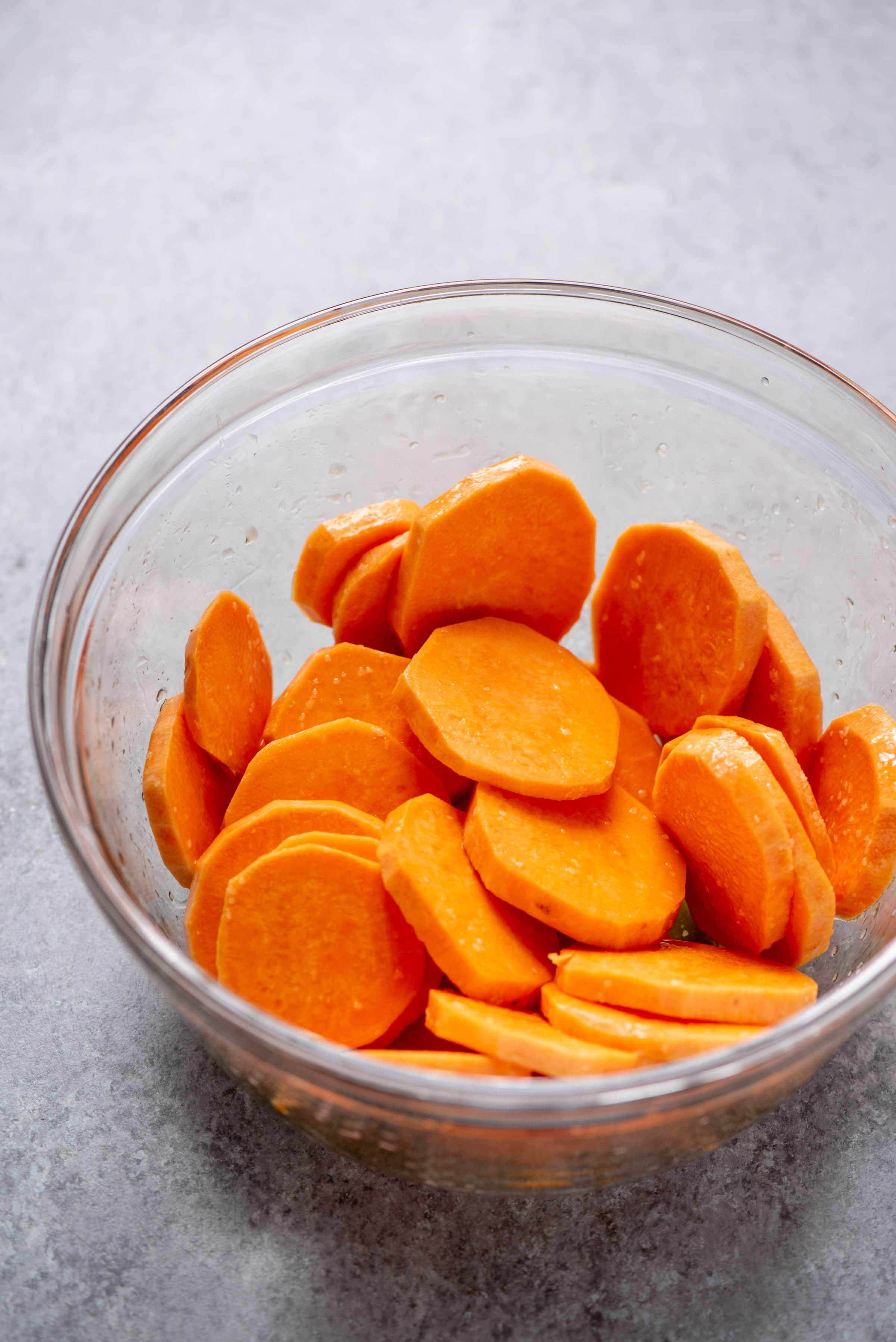 Sweet potato slices in a clear glass bowl