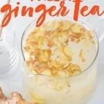 """Glass pitcher full of ginger tea, next to fresh ginger root. A text overlay reads, """"How to Make Fresh Ginger Tea."""""""