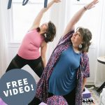 "Two brunette women standing on yoga mats in a Reverse Warrior position, practicing some gentle yoga. A text overlay reads ""Body Awareness Yoga Practice. Free Video!"""