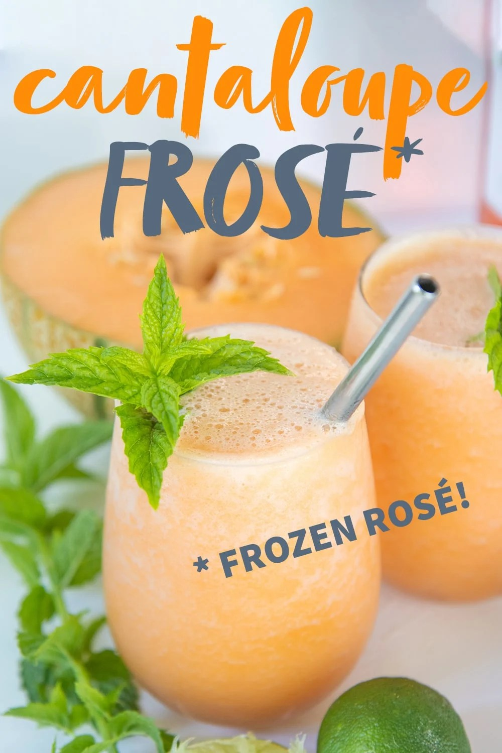 """Two glasses filled with cantaloupe frosé, garnished with mint and straws. A halved cantaloupe and mint sprigs surround the glasses. A text overlay reads """"Cantaloupe Frosé *Frozen Rosé"""""""