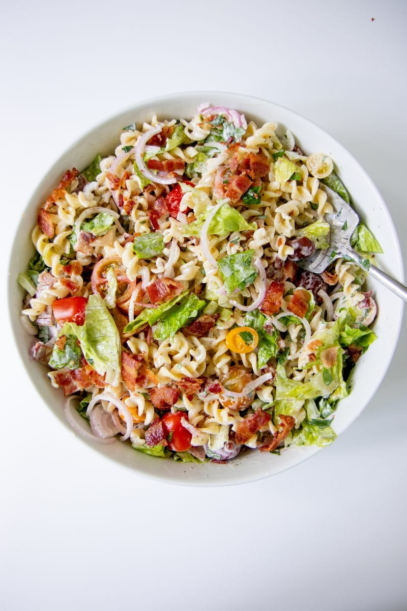 Ranch BLT Pasta Salad in a white bowl on a white background