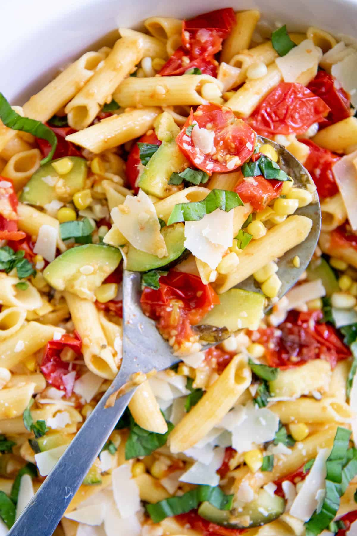 Close up of Summer Roasted Vegetable Pasta with a spoon scooping some out.