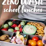 "Hands holding a filled bento-style lunch box for a waste-free lunch. A text overlay reads ""How to Pack Zero Waste School Lunches."""