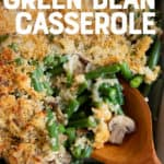 "A wooden spoon scoops some fresh green bean casserole out of a white baking dish. A text overlay reads ""Healthy + Fresh Green Bean Casserole."""